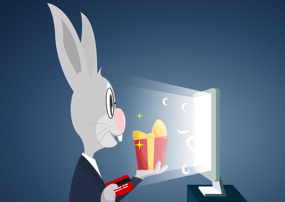 Zaštitni znak servisa za izradu sajtova naKlik, sivi zec koji drži poklon i karticu i pruža ih monitoru od kompjutera.